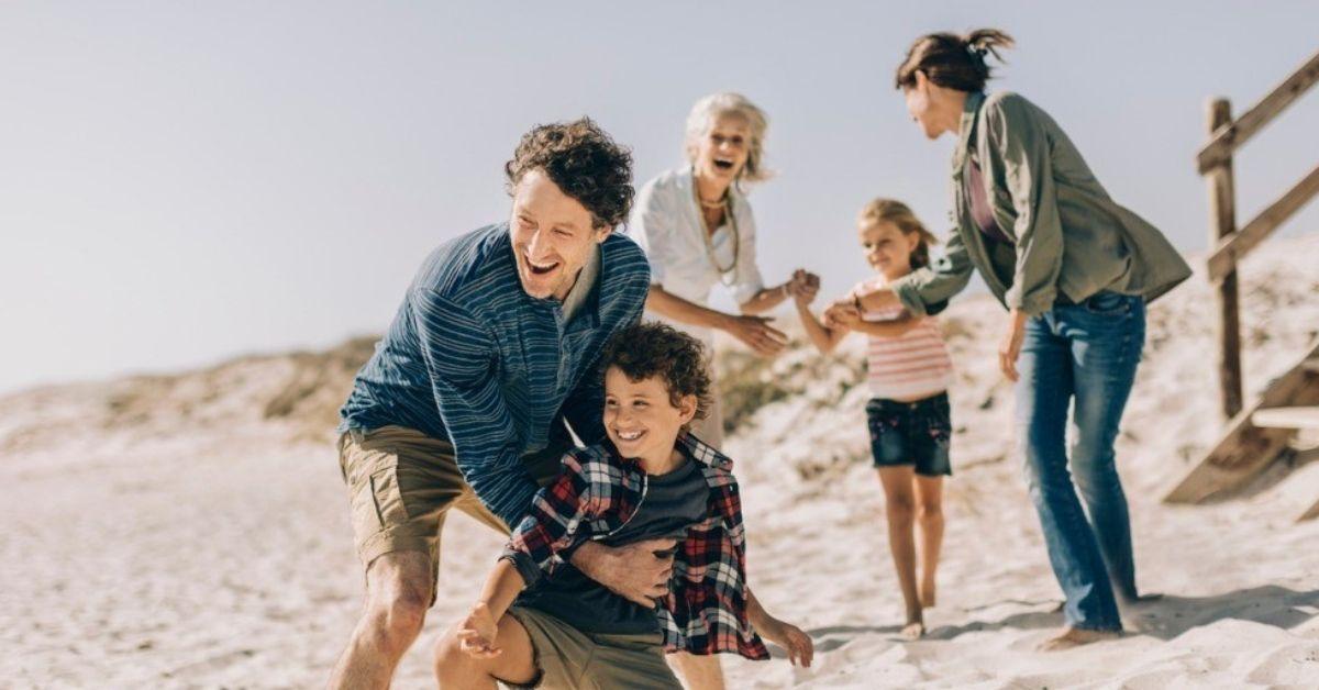 A family has a good time on the beach